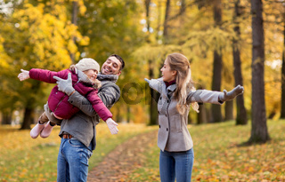 happy family playing at autumn park