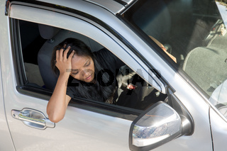 Stressed young woman driving a car. Unhappy woman sitting in the car Shortly after the accident.