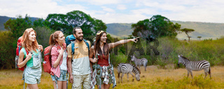 friends with backpacks over african savannah