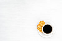 Cup of coffee with crackers