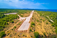 Abandoned and destroyed airport runway in Zadar Sepurine aerial view