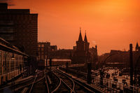 Berlin Cityscape during sunset with train over Oberbaum Bridge between Kreuzberg and Friedrichshain