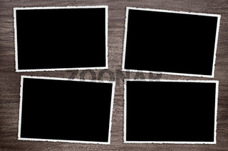 four old vintage photos on wooden background