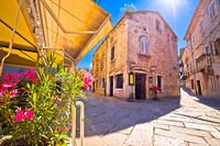 Sunny stone street of ancient Pula view