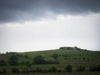 Dark landscape with boulder and clouds in burgenland Austria