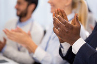 happy people applauding at business conference
