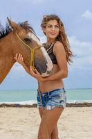 Hispanic Brunette Model And Horse