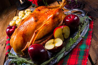 festive stuffed roast goose with red cabbage and dumplings
