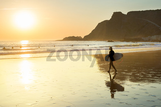 woman surfboard walking beach Portugal