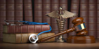 Gavel, stethoscope and caduceus sign on books background. Mediicine laws and legal, medical jurisprudence.