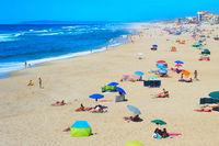 People ocean beach sunbathe Portugal