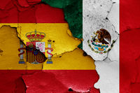 flags of Spain and Mexico painted on cracked wall