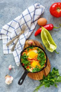 Shakshuka-eggs in tomato sauce.