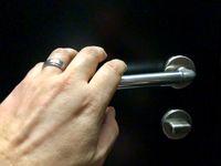 hand approaching door knob