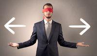 Covered eye businessman choosing direction