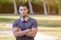 Young latin man runner running jogging sports training fitness