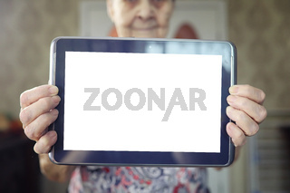 elder woman holding tablet