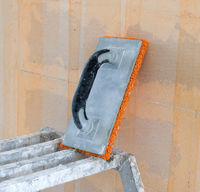 Small steps and a sponge used for plastering