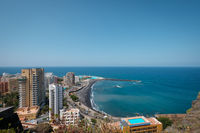 City and beach aerial of Puerto de la Cruz with ocean horizon background