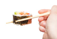 chopsticks holds western-style sushi roll isolated