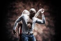 Young and saxy couple dances Caribbean Salsa