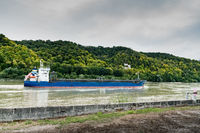 blue and white freighter container ship traveling along the Seine River from Paris to the English Channel