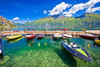 Speed boats on colorful Lago di Garda lake view,