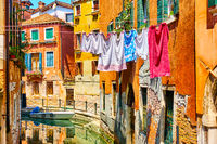 Colorful old houses by canal in Venice