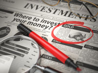 Gold is a best option to invest. Where to Invest concept, Investmets newspaper with loupe and marker.