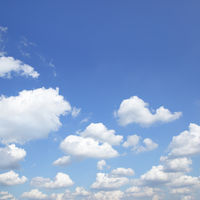 Blue sky with white heap clouds -  background