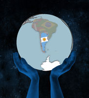 Argentina on political globe in hands