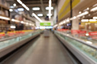 Blurred Interior of a Supermarket