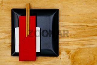 Black ceramic bowls  and bamboo chopsticks