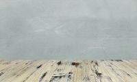 washed wood table with concrete texture background.