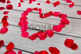 close up of red rose petals in heart shape