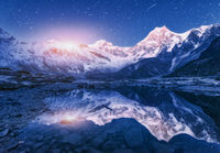 Himalayn mountains and mountain lake at starry night in Nepal