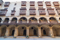 Facade of caravansary of Bazaraa, with vaulted arcades and wooden oriel windows, Cairo, Egypt