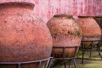 Antique Huge Ceramic Jars Placed on a Forged Pedestals