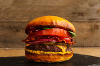 Hamburger on wooden background