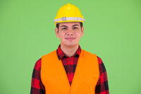 Face of young multi ethnic man construction worker