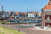 Inner harbor medieval Dutch city Vlissingen with yachts and restaurants