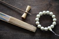 Beads and Incense on wooden table