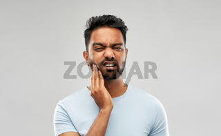 indian man suffering from toothache