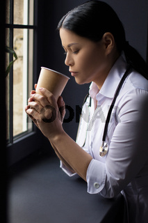 Nurse drinking coffee.