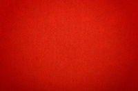 Scarlet red felt background texture close up