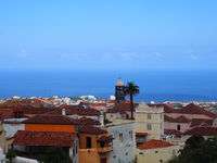 panoramic  view of La Orotava in Tenefife showing colourful painted buildings and the sea