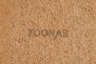 Muster einer braunen Holzfaserplatte als Hintergrund und Textraum