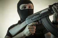 Thief, man armed with shotgun and bulletproof vest