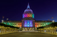 San Francisco City Hall illuminated in rainbow colors for the Pride Parade.
