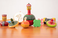 Colourful different types of GI Tagged channapatna toys on table with isolated background.